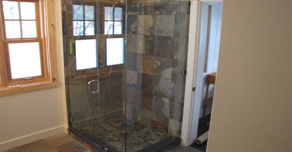 shower with stone wall