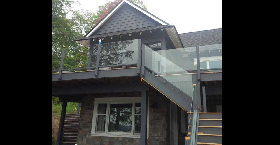 two story house with glass railings