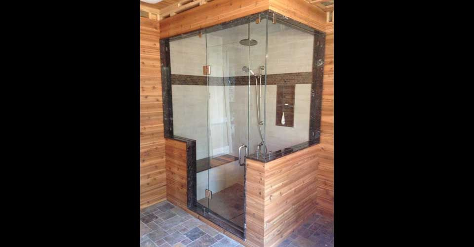 glass shower in wooden cabin