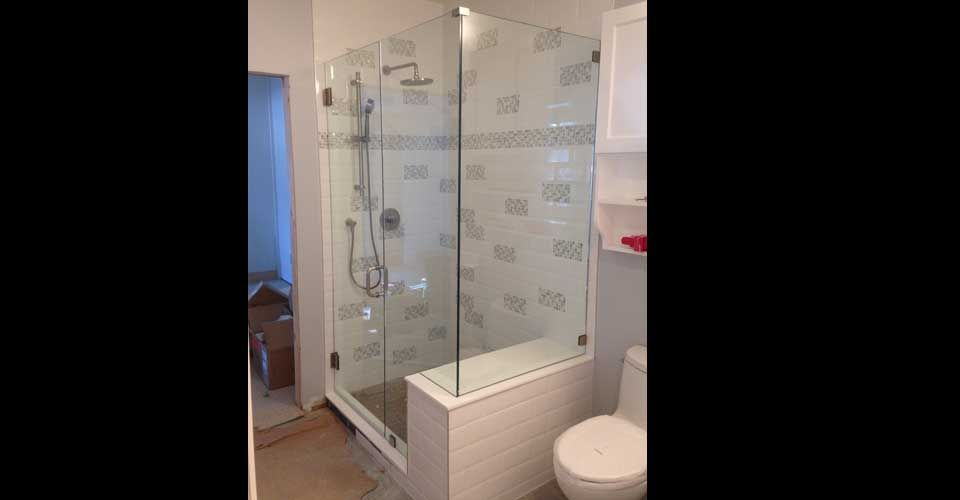 rectangle shower next to toilet